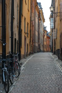 Image of narrow street with residential buildings close together