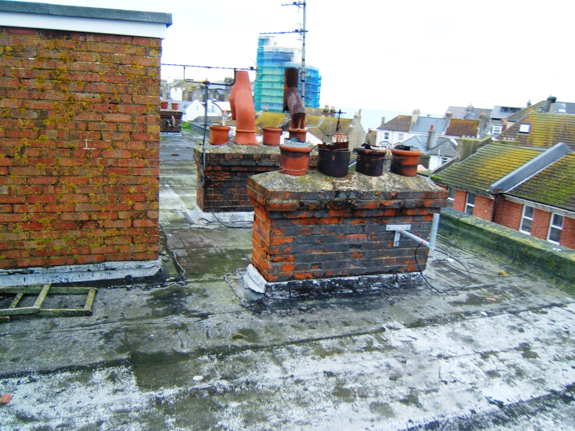Open chimney pots causing water ingress