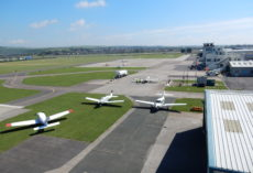 Aerial view of planes and runway at Shoreham Airport