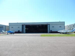 Premier House, Hangar 1, Shoreham Airport shot from a distance - doors open